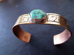 Brass,silver and turquoise.