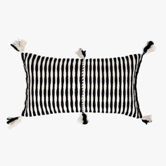 Our Antigua Black Lumbar Pillow from Archive New York is accentuated with tassels and a handwoven textile. Artisan made in Guatemala.