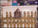 I painted a sweet fence in front of a window seat! My girls loved this!