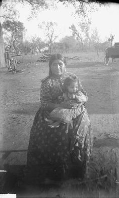 Minnie Parton, a Caddo woman with her child, Charley Parton. 1891. No additional information re: this photo.