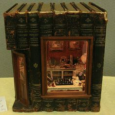 "Photos of Roomboxes from the Fall 2010 Seattle Dollhouse Miniature Show: The exterior of the 1:12 scale roombox  ""Ode to Susan Harmon"" built into a set of recycled books by Janey Elliot"