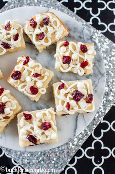 Cranberry Almond White Chocolate Brownies are chewy and fudgy and completely irresistible! This is a festive, easy dessert recipe perfect for the holidays! | Back For Seconds