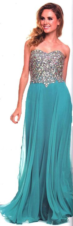 Prom Dresses Evening Dresses<BR>564<BR>Long strapless sweetheart neckline dress embellished with chunky stones.