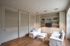 TNESC's sleek and practical shutter solution to screen large glazed areas or divide rooms. Interior Shutters, Wooden Window Shutters, Kids Shared Bedroom, Room Divider, Furniture, Interior, Half Walls, London Residence, Living Spaces