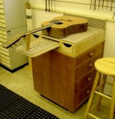 Guitar Workstation - Homemade guitar workstation adapted from a cabinet. Measures 24