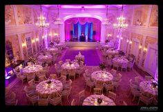 Purple lighting, blush table setting, gold flatware.