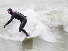 Canadian surfing gear.  Note the hat and gloves!  Our best waves are in winter.  Crystal Beach, Ontario