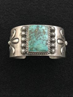 RA's Treasures presents this Native American turquoise sterling silver cuff. Marked by designer Charles Johnson, and sterling. Weight 89g, inside diameter is 5 1/2 inches, width is 1 1/4 inches, and gap opening is 1 1/2 inches wide. Turquoise stone is 1 inches long and 3/4 of an inch wide. | eBay!