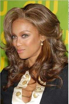 Tyra's hair is cut in layered and is long.Her hair colour is a dark brown with lighter brown highlights.
