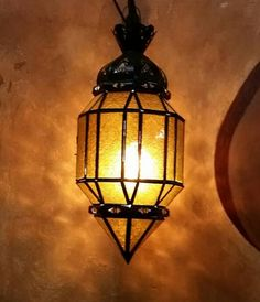 Beautiful handmade Moroccan lantern with amber color glass, made of sturdy metal, rustic copper finish, and measuring around 16 in height and 7 in width. Turkish Tiles, Moroccan Tiles, Moroccan Decor, Moroccan Bedroom, Foyer Pendant Lighting, Moroccan Lanterns, Moroccan Interiors, Amber Color, Amber Glass