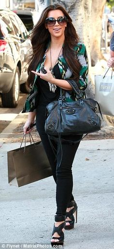 Kim Kardashian wearing Balenciaga City Bag In Black Dita Wonderlust Sunglasses J Brand Audrey Denim Leggings Proenza Schouler Stitched Leather Sandals in Black Dita Marseilles Sunglasses. Kim Kardashian Shopping in LA August 18th 2010.