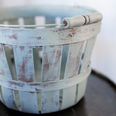Cheap basket from Michaels. Take out every other strip and paint & distress.  Such a cute idea!