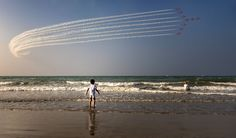 Planes fly in formation in celebration of Oman's National Day in this National Geographic Your Shot Photo of the Day.
