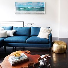 We think every room should have a gold moroccan pouf, don't you think? {via @sarahshermansamuel}