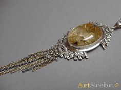 Pendant with rutile