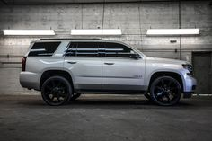 """2015 Chevrolet Tahoe 1500 LS 4x4 with a brand new Katzkin Leather seats installed in all 3 rows as well as 24"""" KMC Slide Wheels wrapped in Ohtsu ST5000 All-Season Radial Tires to add a level of luxury that will leave an outstanding mark."""