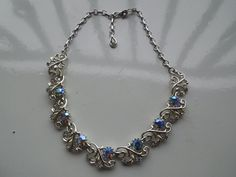 Vintage Coro Necklace, Signed. Spectacular Blue and Aurora Borealis Rhinestones Set in Silver Tone  Ask a Question $40.00 USD