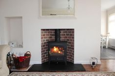 Clearview Vision 500 #woodstove with reclaimed brick slip curved chamber and slate hearth, just need some dry wood! pic.twitter.com/zMBVVYSQnA