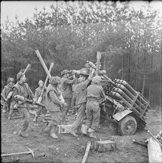 British troops loading rocket projectiles in preparation for the offensive in the Reichswald Germany.