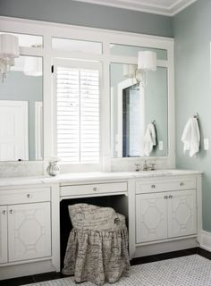 Frame the naked mirror in the master bathroom.