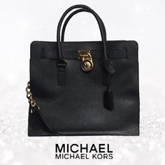 Michael Kors Hamilton Bag! Black & gold Hamilton Bag. Barely used.. I think I carried it for 3 days maybe. Super clean! Comes with dust bag! Still has tags & cleaning instructions inside. Michael Kors Bags