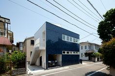 Japanese studio Naf Architect & Design rounded one corner of this Tokyo home to broaden a footpath, then clad the walls in glossy midnight-blue tiles to offer reflections of the streetscape