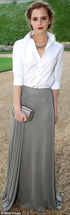 Emma Watson is effortlessly stunning and British, wearing a crisp, white shirt and a full-length skirt, both by Ralph Lauren.