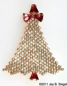 Brooch - ornamental pin with a clasp to attach it to a garment.