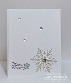 handmade winter card: Snow Falls by simplybeautiful ... all white ... clean and simple ... negative space die cut snowflake backed with glitter paper ... luv the sparkle ...