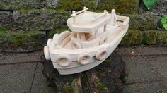 This beautifully handcrafted wooden boat will inspire imaginative and active play. This boat is made from natural pine with an unpainted finish. This boat will float. Approximate size 15 inches long 9 inches wide 7.5 inches tall *Please be aware of the choking hazard with smaller children. These toys have a few small parts that may break off with excessive rough or improper use.*