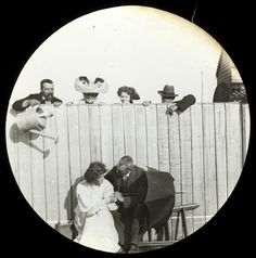 Man pretending to pour water over couple in Valentine's Day 1909