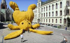 Florentijn Hofman - Stor Gul Kanin  The Big Yellow Rabbit is a temporary 13 meter high sculpture. It's a enlarged cuddle toy made out of swedish products thrown against the statue of Engelbrekt.
