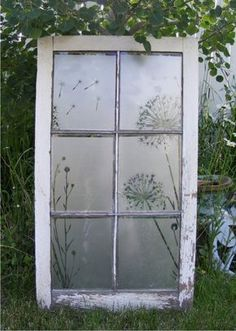 """antique window with etched glass vinyl dandelion design / each pane approx. 10"""" x 8"""".  Price approx: $49 -59 (vinyl only / window not included) contact us for custom vinyl orders: vinylwww.wordplaydesigns.net"""