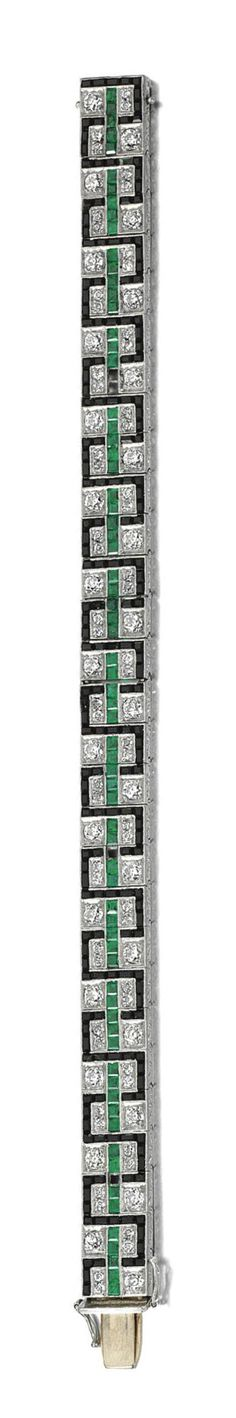 ONYX, EMERALD AND DIAMOND BRACELET, EARLY 20TH CENTURY The articulated band millegrain set with calibré-cut onyx and emeralds, interspersed with circular-cut diamonds, to a scroll engraved gallery