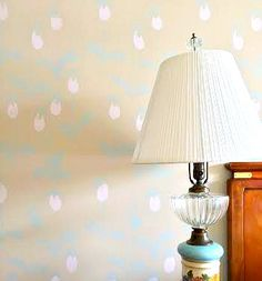 A DIY stenciled accent wall in a bedroom using the Lady Slipper Allover pattern. http://www.cuttingedgestencils.com/orchid-floral-stencil-pattern.html