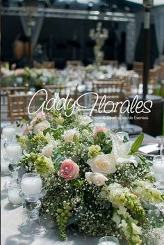 Estuardo & Denise's Wedding in Guatemala. Different styles of floral centerpieces.  Wedding Planner: Dream Events Decoration: Addy Florales