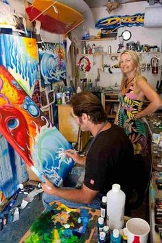 Maria Brophy and husband surf artist Drew Brophy in the studio. His work is extensively licensed. Photo Credit: David Macomber