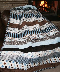 "Who wouldn't want to snuggle up in this quilt while studying for finals or just curled up reading a book??  Made from the softest snuggly cuddle and ultra plush minky fabrics, the rich dark and milk chocolate browns, together with the soft hued blues, are certain to keep mom's 'hugs' and dad's 'tough love' within reach! This cozy quilt measures a generous 60"" x 84"" and the colors are perfect for the college go-getter ... and anybody who needs to cozy up! The pattern will be available for…"