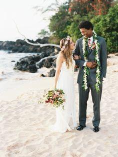 """Say """"I do"""" with waves crashing in the backdrop. #hawaiianwedding #beachwedding #Hawaii #weddingideas"""