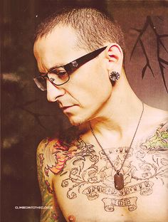 Chester Bennington from Linkin Park. Love tattoos on guys, just not on me..lol