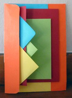"""Cathy Miranker says, """"Simply nesting different-size envelopes and sewing or stapling them together through the fold can make an eye-catching structure. I found all the envelopes for this project at SCRAP."""""""