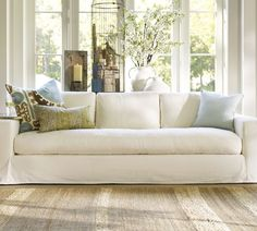 Solano Sofa - Pottery Barn - covered in Everyday Suede (Oat) Furniture, Slipcovered Sofa, Home Living Room, Home Furnishings, Home Furniture, Home Design Living Room, Furniture Upholstery, Deep Sofa, Rugs In Living Room