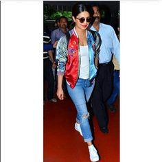 Glam Gal - @priyankachopra Glam Point - Airport Glam Tip - Add a quirky jacket to the basic white tee + blue jeans combo for a fun element! -Your Glam Pal, Srishti