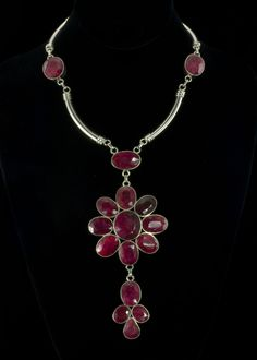 """Ruby Necklace  Natural rubies are surrounded by sterling silver. Necklace is 12"""""""" with a 4-1/2"""""""" extender chain with hook clasp. Total drop length is 6"""""""". This necklace is long and beautiful, lots of rubies and silver.   http://www.sterlingjewelrystores.com/product633.html"""