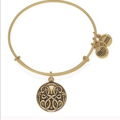 Alex & Ani path of life bracelet gold Emblematic of life's zenith and nadir moments, the PATH OF LIFE is representative of an infinite number of possibilities and expressions of love. Illustrating life's twists, turns, and unexpected winds, wear the PATH OF LIFE Charm to proudly celebrate your own willingness to travel towards life's fruitful moments. Alex & Ani Jewelry Bracelets