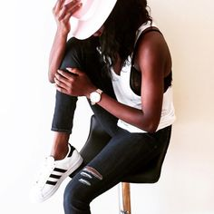 Casual vibes with @hannahakinyemi in @dstld white racerback tank + ripped skinny jeans