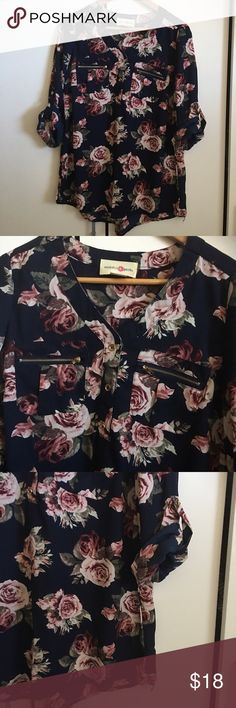 """Wishful Park Navy Blue Floral Tunic Blouse Beautiful! Great condition! Wishful Park Navy Blue Floral Tunic Blouse. Floral print is in pinks, mauves, white and green roses. Gold buttons and gold zipper details. Polyester. Sleeves can be worn rolled up or down. Slight hi-lo hem. Looks great with boots and leggings now and shorts and sandals when the weather heats up. Bust 42"""", length 28"""". Wishful Park Tops Tunics"""