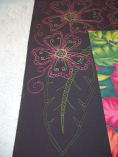 Love the black border with the colored thread