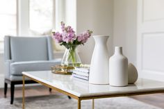 White top coffee table with flowers and vases