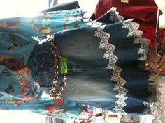 DIY denim w/lace skirt: cut off, sew together old jeans, add lace to bottom and at seam of flounce.